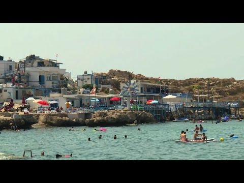 Lebanese shun pricey, polluted beaches for trips abroad