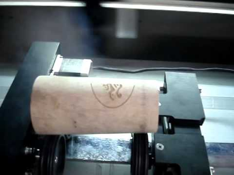 Laser engraving machine with roller-type rotary device