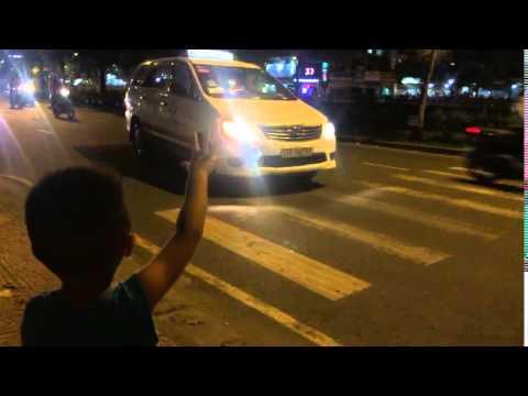 Aidan getting me a taxi in Vietnam