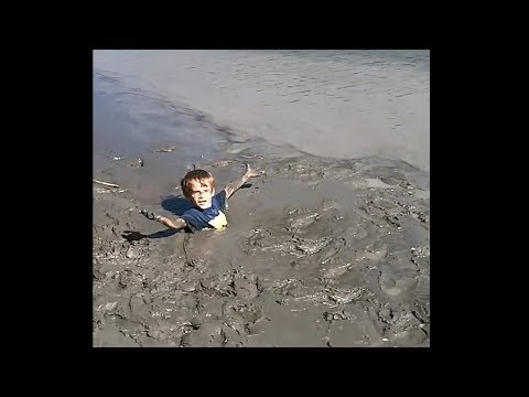 kid gets trapped in deep quicksand......