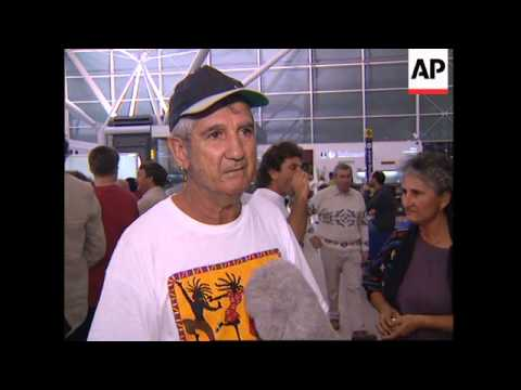UK: BRITONS WHO FLED SIERRA LEONE COUP ARRIVE AT STANSTED AIRPORT