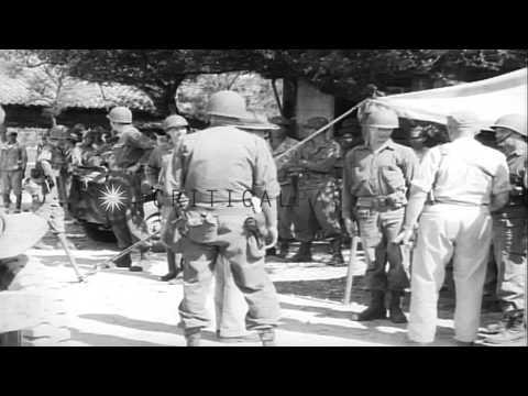 General Joseph W. Stilwell on an inspection tour near a beach area in Ishigaki, J...HD Stock Footage