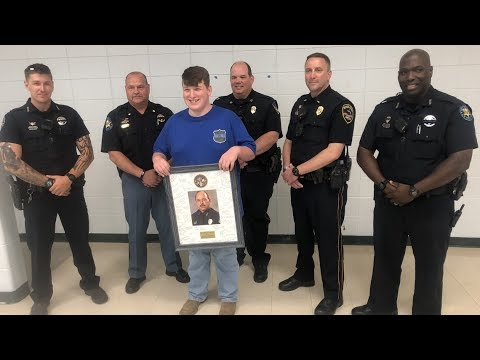 Coast school surprises slain Biloxi police officer's grandson with special gift
