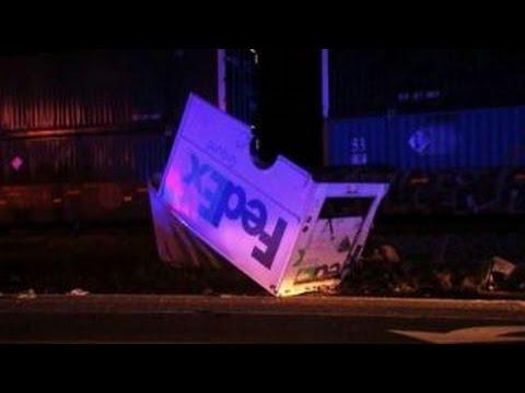 Freight train destroys FedEx truck