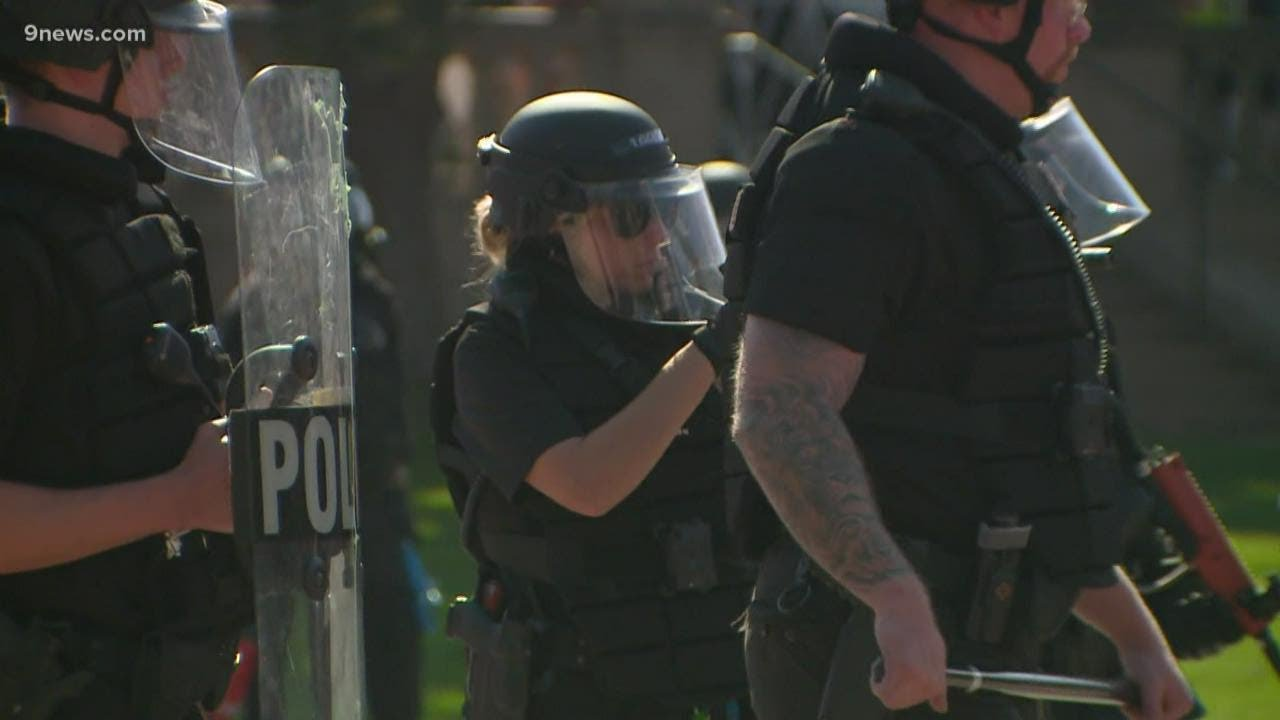 Download 1 dead, security guard in custody after shooting near dueling Denver rallies