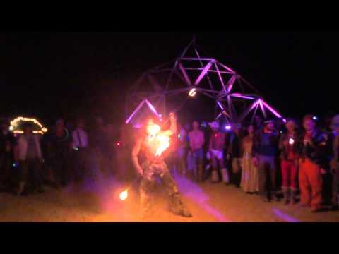 Fire spinner at Disorient camp Sat.