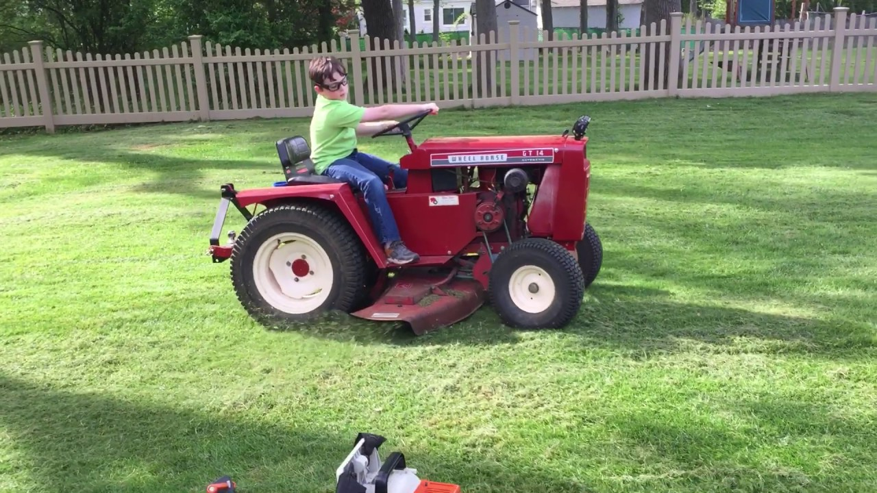 Wheel Horse Gt14 : The mower deck is mounted to wheel horse gt