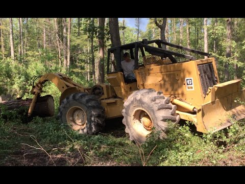 Caterpillar 518 Skidder Pulling a Huge Pine Log!