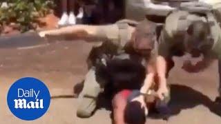 Cops pepper spray black teen before slamming his head into pavement