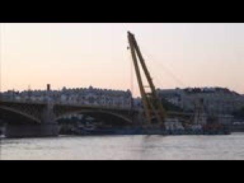 Huge floating crane set up to raise sunken tour boat