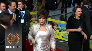Joan Collins dazzles at premiere of new film