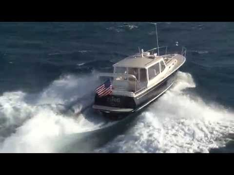 MJM Yachts 40z In 6-8 foot waves off Palm Beach, FL