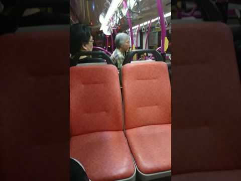 Auntie ask people to change money in Singapore bus 65