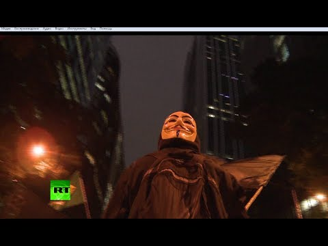 'We are Legion!' Video of hundreds of Anonymous activists marching in US & Brazil