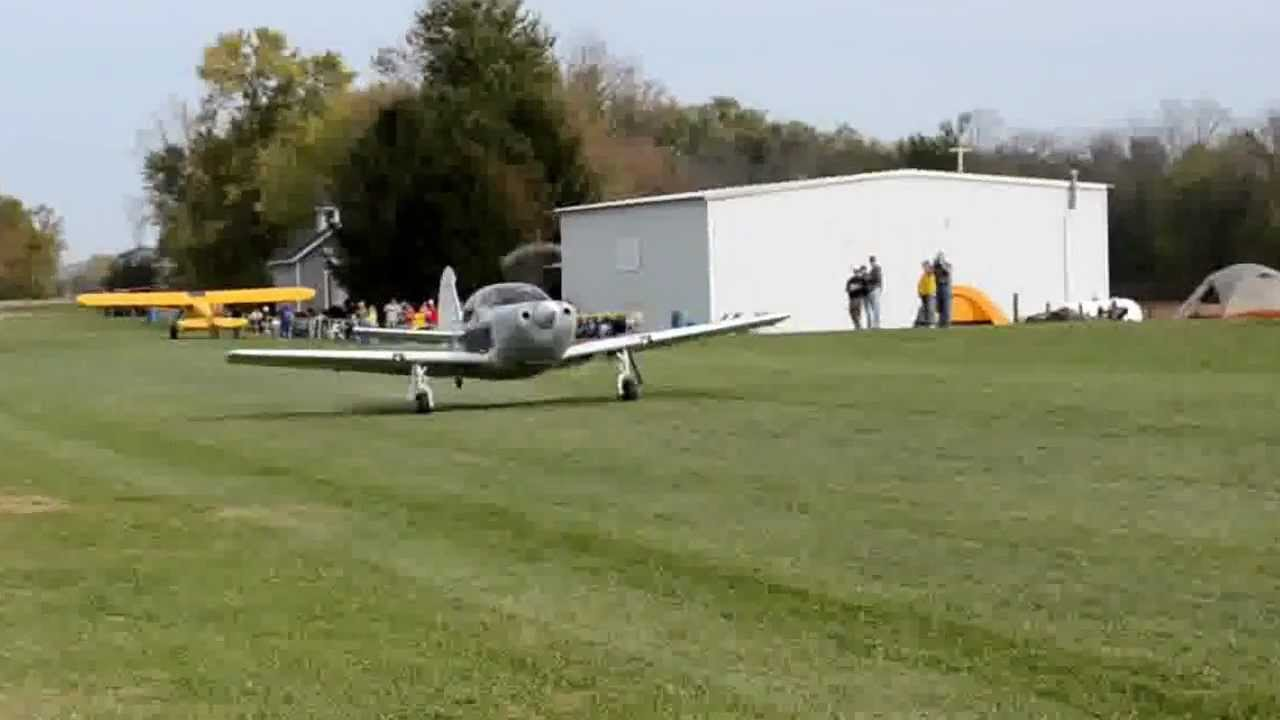 Globe Swift GC-1B N2429B takeoff from grass strip
