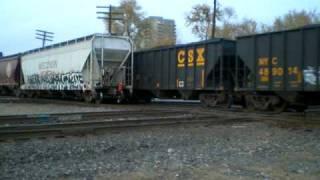 Loud! Six diamonds in play - Slow race between CSX coal and CSX local freight at Columbus Jct.