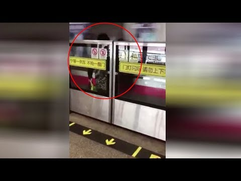 Woman trapped behind subway safety doors as train speeds by