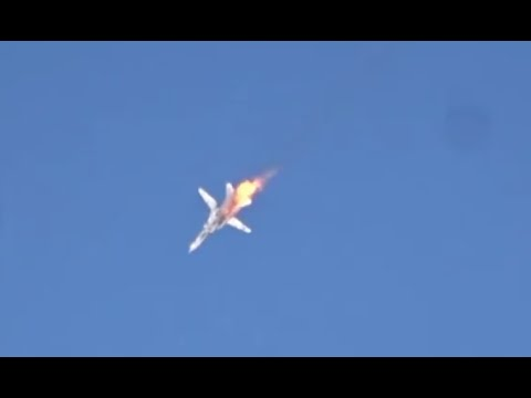 Close-up footage of Russian Su-24M jet falling in flames hit at Syria-Turkey border