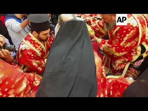 Orthodox Christians gather for Washing of the Feet ceremony in Jerusalem