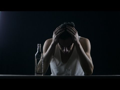 Depressed Man Crying With a Bottle Of Vodka. Man In Despair | Stock Footage