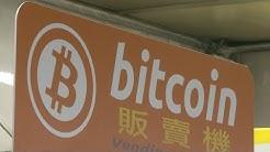 Bitcoin hits record high amid bubble fears