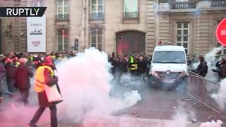 RAW: French police deploy tear gas and pepper spray during protests against fuel prices