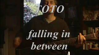 Toto falling in between bass player