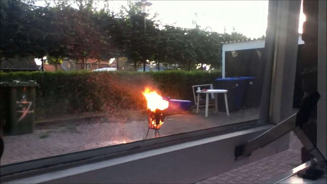 3 aerosol cans in to the fire. - YouTube