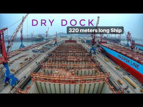 Massive Ship entering Dry Dock .
