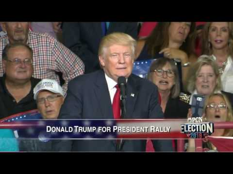 Sue Helm And Lou Barletta Cheer And Grin During Assault At Trump Rally