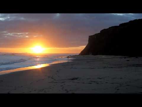 MVI_5468 12s, B-roll, Pillar pt. Surfer exits ocean at sunset _mpeg4.avi