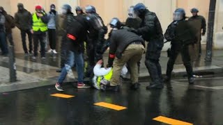 """""""Yellow vests"""": Arrests, water cannons on the Champs-Elysees"""