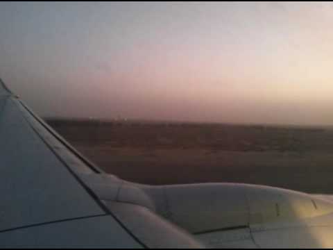 Aeroplane landing in kuwait in the evening. Beautiful view