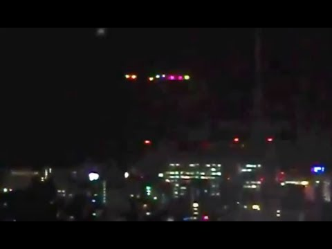 MASSIVE UFO WITH MULTI COLORED FLASHING LIGHTS ON NEWS - ASIA - 2017