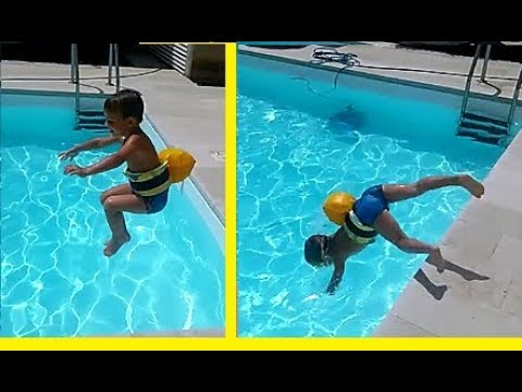 bce6d75ca9826 Kid Dives in the Pool at 4 years old with Decathlon Belt. Tuffi in piscina.