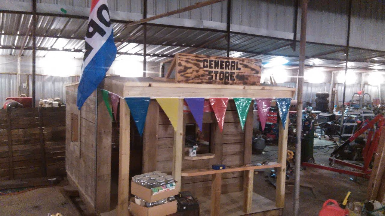 General store playhouse made from pallets and scrap wood for How to build a playhouse out of pallets