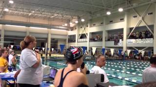 12 year old swimmer sings National Anthem at swim meet
