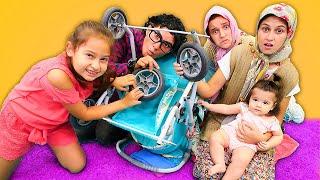 Fındık Ailesi. Asiye Selin'e bebek arabası alıyor. Alışveriş oyunu