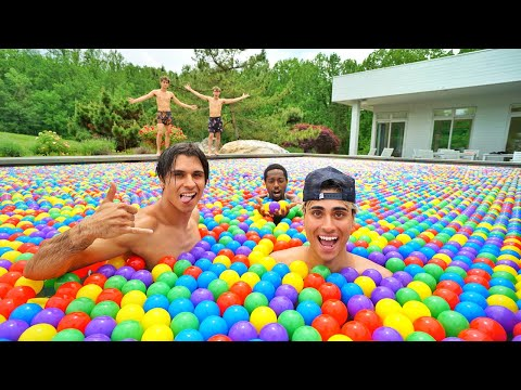 We Put 100,000 Rainbow Balls In Our Swimming Pool!