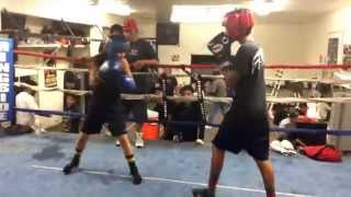 Alfonso and Cindy sparring  . Respect all, fear none  . Don