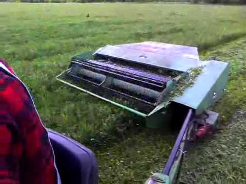 Farmall 400 pulling a John Deere 1219 through clover - YouTube