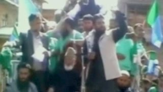 Pakistani flag waved at Syed Ali Shah Geelani