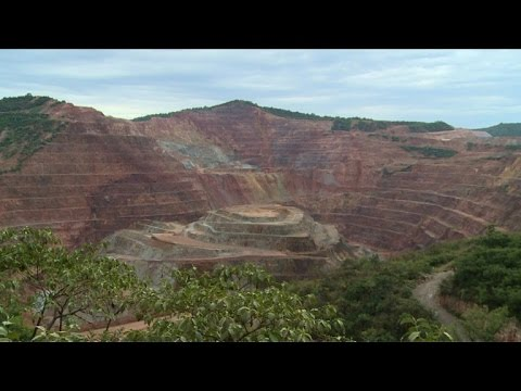Canadian mine digs up gold, Mexican town digs up bodies