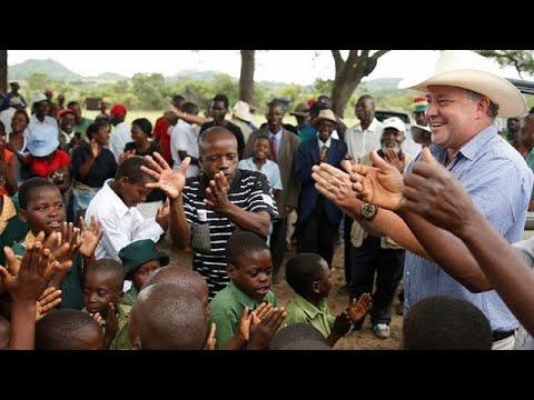Celebration in Zimbabwe as a white farmer returns to seized land