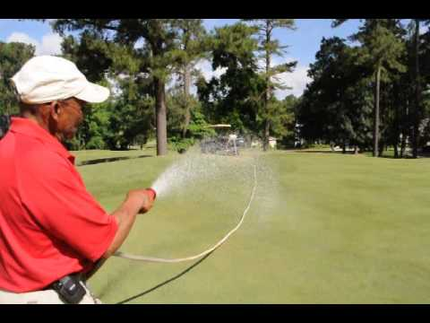Caring for golf greens at Wildwood Green Golf Club ~ Raleigh, NC