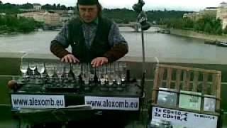 Representation of Alexander Zoltan playing on his Glass harp - Karol Bridge, Prague