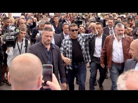 Sylvester Stallone crossing the Agora with a massive crowd of fans at Cannes