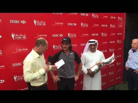 Tommy Fleetwood collecting the 2017 Abu Dhabi HSBC Golf Championship falcon trophy