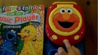 Sesame Street Music Player Storybook [With Music Player u0026 4 CDs] - Elmo CD Player