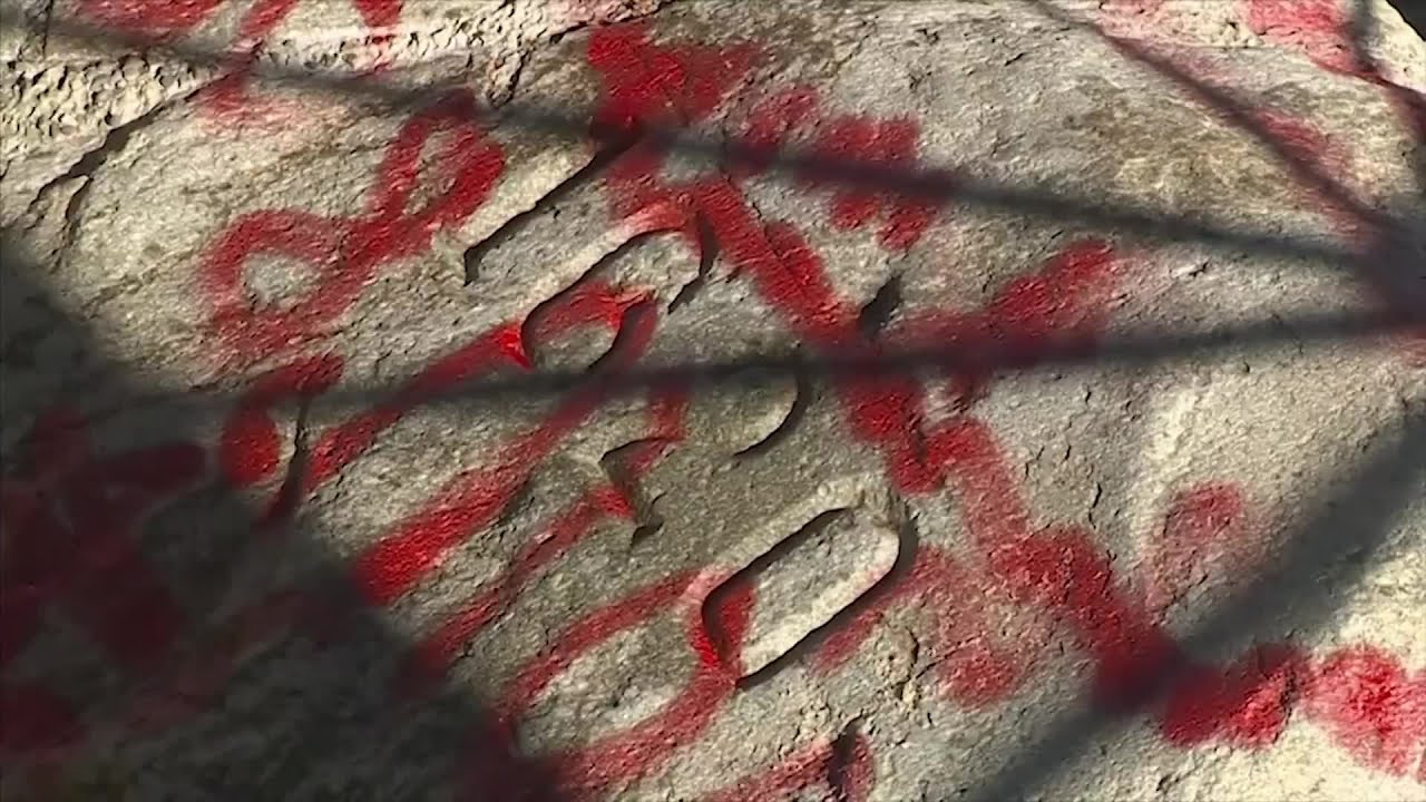 Vandals cover Plymouth Rock in red graffiti